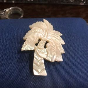 Mother of pearl brooch 2 inches tall 1 1/4 wide